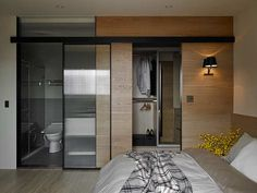 Modern master bedroom design idea with small bathroom and beautiful dressing in an inviting apartment in Taiwan - by Awork Design Studio Small Apartments, Small Spaces, Dream Home Design, House Design, Sideboard Modern, Wooden Sliding Doors, Family Apartment, Interior Decorating, Interior Design