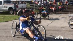 """PINELLAS PARK, FL (WFLA) — Pinellas Park resident, Michael DeLancey, celebrates September 1st as his """"Alive Day."""" Exactly nine years ago, a sniper shot him in Iraq. DeLancey is now paralyzed from the waist down. He hit the road, on an adaptive bike, along with other veterans and supporters Tuesday morning to raise awareness. """"When…"""