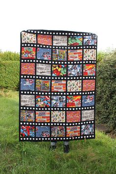 IMG_0689 by lolabella2009, via Flickr  Fat Quarterly Issue 5 Comic Strip quilt.  This would be a great layout to use with the comic fabrics, unfortunately no instructions but should be easy to come up with a pattern.