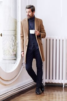 Try pairing a khaki overcoat with navy jeans to create a smart casual look. Finish off this look with black leather brogues. Shop this look on Lookastic: https://lookastic.com/men/looks/overcoat-cardigan-turtleneck/15233 — Navy Turtleneck — Navy Cardigan — Camel Overcoat — Navy Jeans — Black Leather Brogues