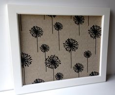 Modern, stylish and definitely unique. Show off your favorite photos or display place cards for a bridal shower or wedding with this well made, framed magnetic memo board. A decorative and functional addition to home, office or special event.  The sophisticated black and tan large scale dandelion pattern is simple and modern. This medium weight 80% cotton, 20% rayon textural woven fabric is the perfect shade of tan - neutral but interesting. A gorgeous backdrop to what ever you choose to…
