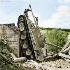 A German Panther Ausf G on the flank after crossing a bridge that eventually collapsed because of the 45 tonnes.