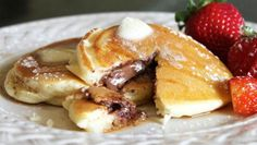 Blogger Arlene Cummings of Cooking With Sugar shares a favorite recipe. These pancakes are a Saturday morning treat in our house. The hot chocolate melting out of the center makes them irresistible.