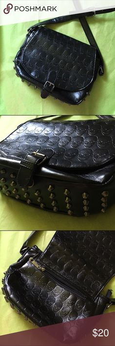 Skull embossed cross body bag Skull embossed pattern on faux leather crossbows bag. Studded bottom. Back zip pocket. Interior zip pocket on one side and dual pockets on other. Clean inside and out. Magnetic closer. Adjustable strap. Not UNIF, just used as target demographic. UNIF Bags Crossbody Bags