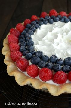 Layers of no-bake cheesecake, lemon pudding, and berries makes this a delicious and pretty summer pie.