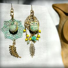 Shabby Chic Boho Owl Mismatch Earrings (handmade) Mismatch earrings with tones of yellow, gold and patina turqouise.. cute little 3D owl charms with coordinating colors. Any questions just ask, thanks for looking! :) Jewelry Earrings