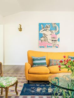 sunny yellow sofa and layered rugs in the living room