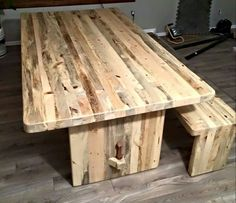 Matching slab style bench and dining table made from beetle kill lodgepole pine from Colorado