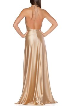 This classic timeless cut is a staple piece for any socialite. Made of the finest jersey material form fitting and flowy. Features a low back, high slit with wrap front that adjust to fit on waist lin