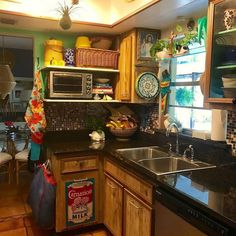 A definitive case of striking boho kitchen, the da Bohemian Kitchen, Rustic Kitchen, Kitchen Ideas, Diy Kitchen, Vintage Kitchen, Kitchen Decor, Dressing Room Design, Microwave Storage, Wooden Cabinets