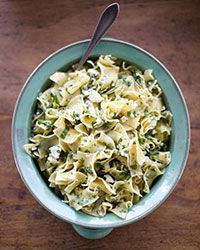 Egg Noodles with Feta and Herbs | Flavors that wind their way throughout Greek cuisine—feta, dill, parsley and mint—come together in this quick, buttery side dish.