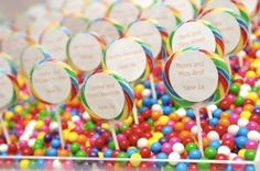 Paint a Rainbow Theme - Rainbow lollipops for place cards, is a very clever idea. But, may spoil the guests dinners'.