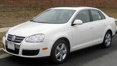 This is my car, a Volkswagen Jetta. The cost of insurance per month is $123.08.