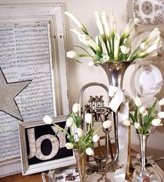 "Floral Fantasy        Black and white may not be your first thought for holiday decorations, but the look is both fresh and contemporary. Silver mixes perfectly with white flowers and a silver satin bow, while framed sheet music sings out more of this musical theme. Add more holiday style with fresh greenery, or turn it into a New Year's party look with sheet music from ""Auld Lang Syne."""