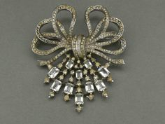 Gorgeous ... Multi bow and stylized flower spray brooch by Alfred Philippe for Trifari, rhodium plated cast base metal with rectengular cut clear glass and clear rhinestones, USA ca. 1948 - Private Collection -