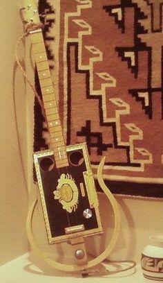 How to Play a 3 String Cigar Box Guitar -- via wikiHow.com