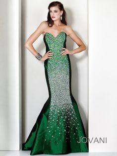 Stunning taffeta/sequins pageant evening gown Jovani 172061. Make yourself famous at your pageant night wearing this evening gown with strapless plunging sweetheart neckline. Uniquely positioned crystals cascade down the center of the bodice until the glamorous mermaid skirt is softly brushing the floor length. This evening gown is available in Black, Red, Royal and White. Teardrop sparkling earrings and strappy platforms will match perfectly this pageant gown.