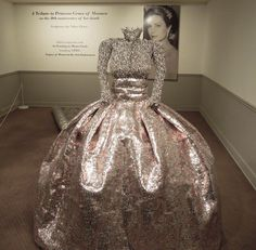 A replica of Princess Grace's wedding gown made from soda cans