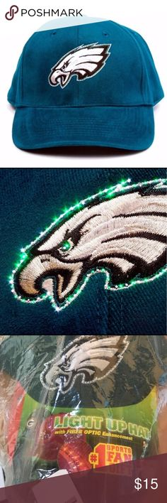 Philadelphia Eagles LED Light-up Adjustable Hat Brand New Officially Licensed with tags. This unique high quality hat has the Eagles logo fiber optically enhanced to display a dazzling array of team colors. A simple on/off switch lets you select between wearing a normal looking hat or turning the lights on and letting everyone see you are a fan. Whether you wear them at the ball game, sports bars, or while watching at home, the light, durable, weather resistant construction ensures years of…