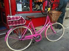 Pink Pashley outside a shop, with pannier & basket