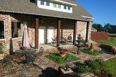 Brick floor for outdoor garden space. Pecan Lakes, Petal, MS  by AAA Homes of MS, LLC