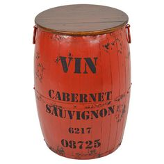 Add a splash of colour to your home with this wood and metal barrel. Whether used to rest drinks beside your sofa or display a statement lamp in your guest b...