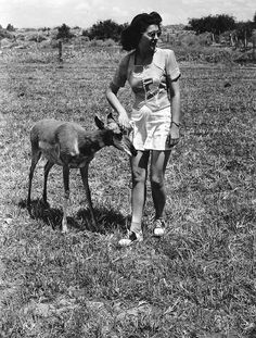 Woman petting an antelope near Hoover Dam, NV. Reclamation file photo, exact date unknown. #TBT #throwbackthursday