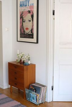 Love the little set of drawers, records, and vintage poster