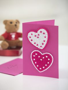 Make this cute hearts card for Valentine's Day! Free craft pattern uses Lion Brand Bonbons and plastic canvas heart shapes.