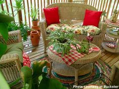 Porch decorating with red - wicker porch furniture makes nice conversation area