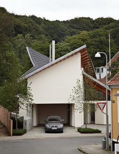 Modern Scandinavian house with a futuristic touch - This stylish house is located in Denmark and it is not Typical Scandinavian style . The Exterior loo. Roof Architecture, Residential Architecture, Scandinavian Home Interiors, Scandinavian House, White Painted Floors, Building A Cabin, Modern Garage, Amazing Buildings, Exterior Design
