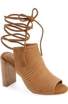 Standing tall with these contemporary mule sandals! They feature slender, leg-wrapping laces while stripes of laser-cut leather add texture to this trendy look.