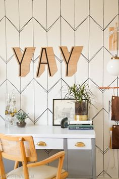 "Geometric sharpie wall with a ""yay"" sign"
