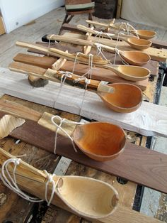 hand carved spoons | nick webb [I presume they're being steam bent to shape after carving]