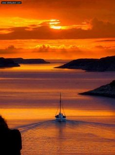 Santorini, Greece. The orange of the sky is so beautiful, it almost looks unreal.