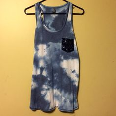 Blue Skye Tie Dye Cotton Tang Top Charlotte Rousse Blue Tie Dye Tang Top. Loose fitting soft cotton, blue sequin front pocket and blue sequin details on the bottom sides on the shirt. Charlotte Russe Tops Tank Tops