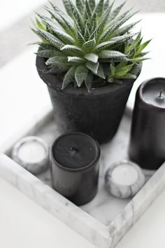 Marble is very in for 2014. Love how soft and beautiful the greys in marble are. Use marble in your Candle Impressions Flameless Candle vignettes to update a room