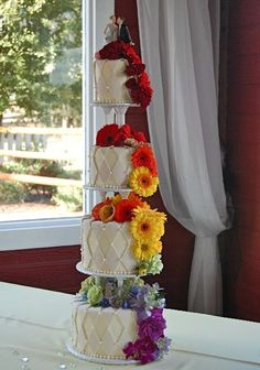 Diamond paned cake with bright flowers      Cake Wrecks - Home - Sunday Sweets: Wedding Wonders
