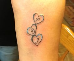My sister had the first initial of each of her three boys put in the hearts