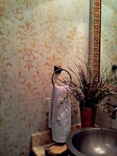 Foliate Damask Stencil Pattern in powder room bathroom walls with patina antique gold look - Royal Design Studio wall stencils and Modern Masters metallic paint