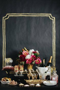 8 incredible New Year's Eve Party Decoration Ideas - DIY black and gold Old Hollywood backdrop and a fully stocked bar station