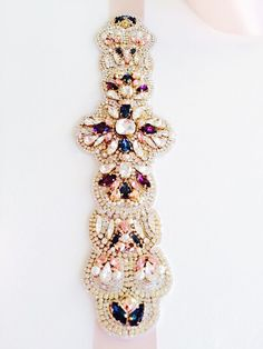 Beautiful pearls and Swarovski crystal beaded sash. This absolutely  stunning sash is just loaded with sparkly crystals and pearls beads in an  intricate ... 14a7d5d206f