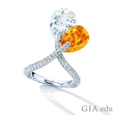 This Fancy Vivid orange #diamond and diamond ring is estimated to sell for US$1.5-1.8M at Sotheby's Magnificent Jewels and Jade show in Hong Kong. With one terminal set pear-shaped Fancy Vivid orange diamond weighing 4.08 carats, and the other terminal set pear-shaped diamond weighing approximately 5.20 ct mounted in 18K white gold, this ring is a sunny 'crossover' design, just in time for Spring. Courtesy: @Sothebys