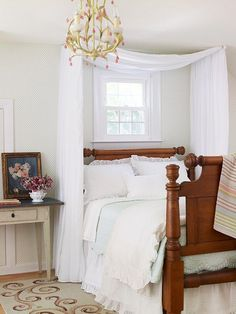 Bedroom - love the draping over the bed & the chandalier
