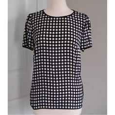 """J. Crew """"Tipped Silk"""" windowpane tee Black and white windowpane print. Size 8. Approximate measurements taken flat: bust 19"""", shoulder 16"""", length 25"""". 100% silk. Occasional slight variations noted to fabric (pictured). Excellent used condition. J. Crew Tops Blouses"""