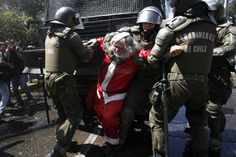 Police arrested a demonstrator dressed as Santa Claus during protests in Santiago, Chile, Protesters demanded changes in education funding. Christmas Horror Movies, Christmas Is Over, Christmas Gifts, Dump A Day, Book Sites, Tumblr, Picture Day, Winter Wonder, Places