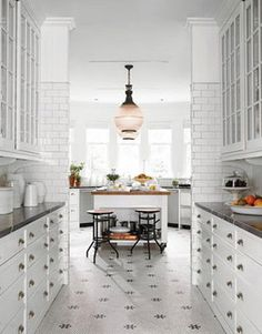 narrow kitchen with every inch being used. so clean & nice