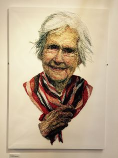 """Art from the """"Dementia Darnings"""" exhibit by Jenni Dutton, at the Festival of Quilts 2015 in Birmingham, England - photo by Lissa, via modalissa blog;  """"Using [photos of her mother], the large portraits, constructed using THREADS sewn through netting that was stretched over canvas, became a way for Jenni to explore the concept of aging and her mother's gradual loss of memory."""""""