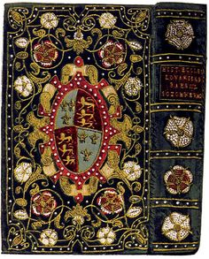 """Historia Ecclesiastica, written by [John] Christopherson, Bishop of Chichester, and printed at Louvain in 1569. """"From each corner of the sides springs a rose spray, with Tudor roses of red silk mixed with pearls, and Yorkist roses all worked in pearls clustering tight together, the leaves and stems being made in gold cord and guimp. """"Restored"""" in Victorian era."""