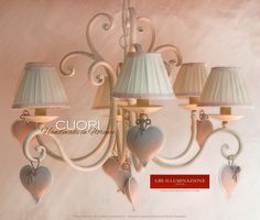 A Heart 6-light Chandelier made of entirely hand-decorated drawn down and forged wrought iron.